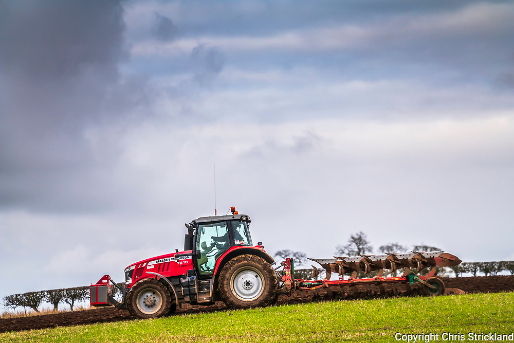 Smailholm, Kelso, Scottish Borders, UK. 19th November 2018. A farmer ploughs a stubble field on an overcast day in the Borders.