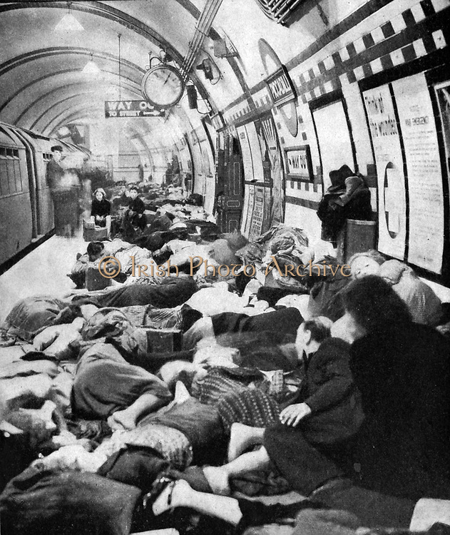Londoners sheltering  on the platform of a station on the Tube (underground railway) during the Blitz. London was bombed on 76 consecutive nights by the Luftwaffe (German Air Force) between July 1940 and May 1941.