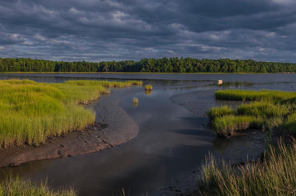 Last light on Wharton Point,with silt, grasses, and canoe,  Brunswick, ME