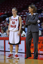 01 January 2009: Redbird coach Robin Pingeton chats with Kristi Cirone during a free throw. The game between the Creighton Bluejays and the Illinois State Redbirds ended with the Redbirds on top by a score of 63-43 on Doug Collins Court inside Redbird Arena on the campus of Illinois State University, Normal IL.