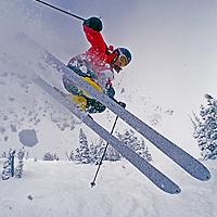 A skier jumps through powder snow on The Ridge at Bridger Bowl, Montana.