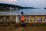 A young student looking at the sea in Santo António do Príncipe