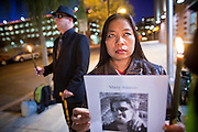 "04 JANUARY 2012 - PHOENIX, AZ:   LOVELY DYSON holds a candle during a vigil for Marty Atencio in front of the Maricopa County Jail in Phoenix on January 4. Atencio died in a Phoenix hospital on Dec 20, 2011. He was arrested by Phoenix police a few days earlier after he exhibited ""bizarre"" behavior on the street. He was booked into the Maricopa County Jail. During the booking process he was tackled by Maricopa County Detention Officers and repeatedly hit was a Taser stun gun. He was later found unconscious in a holding cell and transferred to a hospital, where he died four days later. An autopsy showed no signs of illegal drugs or intoxication and a video from the jail showed that Atencio was not violent in the jail. His family has hired a lawyer and may sue the Maricopa County Sheriff's Department, which administers the jail.      PHOTO BY JACK KURTZ"