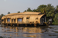"""The main mode of transportation in Kerala Backwaters has always been by kettuvallom which means """"roof boat"""". They are usually made with wood joined  together with coconut ropes and painted with cashew oil outside. Many kettuvalloms have been converted to houseboats with  beds, kitchens and toilets."""