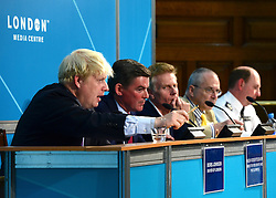 © Licensed to London News Pictures. 28/08/2012. Westminster, UK Left to right Boris Johnson, Mayor of London, Hugh Robertson MP, Minister for Sports and the Olympics, Paul Deighton, Chief Executive of LOCOG, Peter Hendy, Commissioner, Transport for London, Chris Allison, Assistant Commissioner, Metropolitan Police.at a Media Briefing on Security and Transport Readiness at The London 2012 Paralympic Games today 28 August 2012. Photo credit : Stephen Simpson/LNP