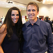 Priscilla Magsig, left, and Heath Magsig pose for a photo Saturday September 20, 2014 during the 4th Annual Care Project Gala at Union Station in Wilmington, N.C. (Jason A. Frizzelle)