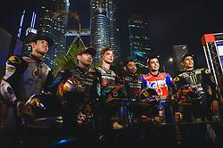 October 31, 2018 - Kuala Lumpur, Malaysia - From left  Malaysian Moto2 rider Khairul Idham Pawi of Idemitsu Honda Team Asia Japanese Moto3 rider Ayumu Sasaki of SIC Racing Team, Finnish Moto2 rider Niki Tuuli of SIC Racing Team, Malaysian Moto3 rider Adam Norrodin of SIC Racing Team, Italian MotoGP rider Danilo Petrucci of Pramac Ducati Team and Malaysian MotoGP rider Hafizh Syahrin of Monster Yamaha Tech 3 pose in front of Malaysia's landmark Kuala Lumpur twin tower in Kuala Lumpur, Malaysia during a pre-event  ahead of Malaysian Grand Prix on October 31, 2018. (Credit Image: © Zahim Mohd/NurPhoto via ZUMA Press)