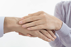 Close-up of woman holding man's hand, Bavaria, Germany