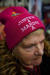 """© Licensed to London News Pictures. 07/02/2017. London, UK. A supporter of Sergeant Alexander Blackman wearing a """"JUSTICE FOR MARINE A"""" hat, outside the Royal Courts of Justice in London, to show support for Sgt Blackman, who is due to start an appeal against his life sentence for the murder of a wounded Taliban fighter in Afghanistan in 2011.  Photo credit: Ben Cawthra/LNP"""
