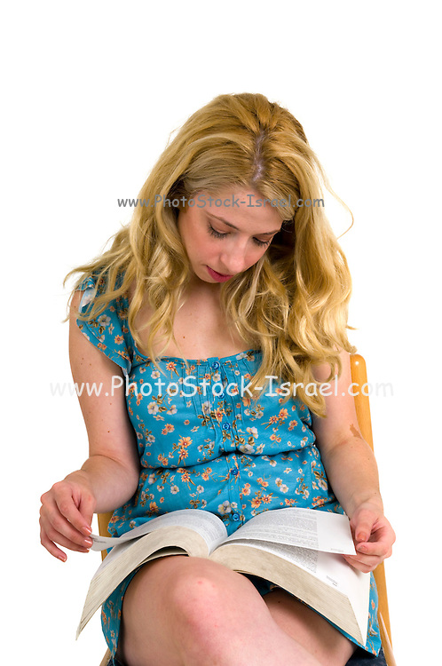 Young blond woman reads a textbook