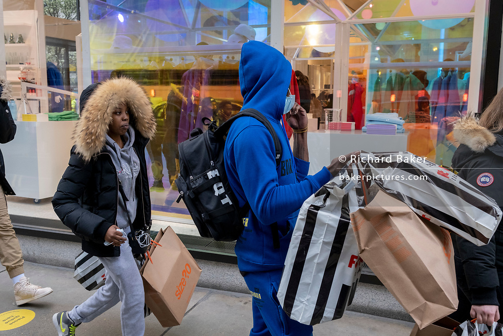 On the day that the UK government eased Covid restrictions to allow non-essential businesses such as shops, pubs, bars, gyms and hairdressers to re-open, shoppers pass Selfridges, on 12th April 2021, in London, England.