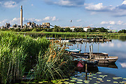 June 30, 2014 - Budel, Noord-Brabant, Netherlands - Fishermen boats parked in the lake shore as reflecting the enlighted shadow of the green earth and blue sky. (Credit Image: © Vedat Xhymshiti/ZUMA Wire)