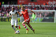 Southampton's  Luke Shaw holds off Swansea's Dwight Tiendalli. .Barclays Premier league match, Swansea city v Southampton at the Liberty stadium in Swansea, South Wales on Saturday 3rd May 2014.<br /> pic by Andrew Orchard, Andrew Orchard sports photography.