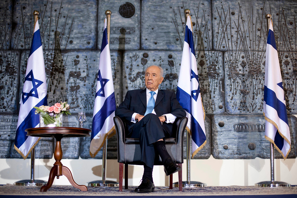 Israel's President Shimon Peres attends a press conference for Arab and Palestinian media before the upcoming Muslim holiday of Ramadan, at the President's Residence in Jerusalem on July 26, 2011.
