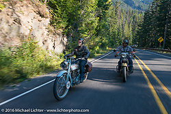 Thomas Trapp riding his 1916 Harley-Davidson F beside Andreas Kaindl on his BMW R75 duringStage 16 (142 miles) of the Motorcycle Cannonball Cross-Country Endurance Run, which on this day ran from Yakima to Tacoma, WA, USA. Sunday, September 21, 2014.  Photography ©2014 Michael Lichter.
