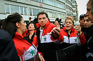 Pro-Assad demonstrators shout slogans and hold images of Bashar al-Assad at a rally outside the Istanbul Congress Centre, where the Second Conference of the Group of Friends of the Syrian People was being held, Istanbul, April 1st 2012. Bradley Secker / ENN