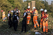 Metropolitan Police officers prepare to return an item removed without permission by an HS2 security guard from an anti-HS2 activist during tree felling works alongside the Grand Union Canal in connection with the HS2 high-speed rail link on 21 September 2020 in Harefield, United Kingdom.  Anti-HS2 activists continue to try to prevent or delay works for the controversial £106bn HS2 high-speed rail link on environmental and cost grounds from a series of protection camps based along the route of the line between London and Birmingham.