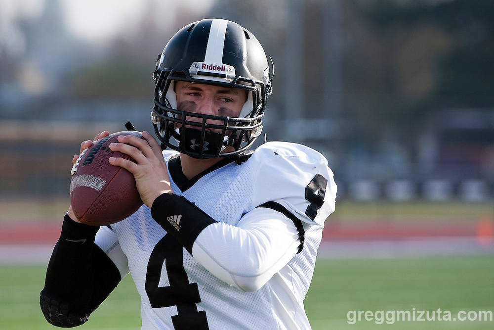 Val sophomore quarterback Cade Perry warms up on the sideline before the start of the second half of the Vale - Scio 3A semifinal playoff game at Kennison Field, Hermiston, Oregon, Saturday, November 21, 2015. Vale won 42-14.