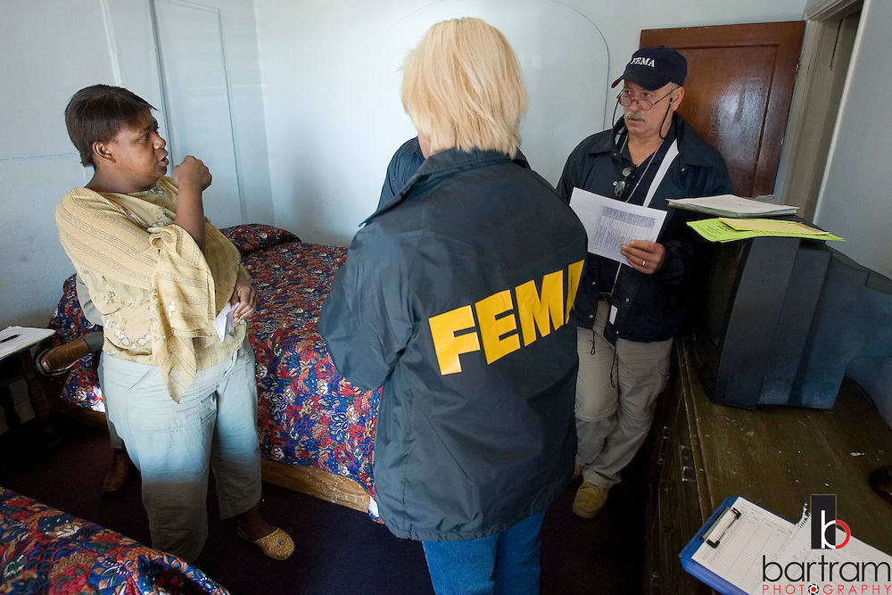 KEVIN BARTRAM/The Daily News.FEMA strike team members Linnie Youngblood, center, and Donald Netleingham, right, talk to Amy Coleman at the Surf Motel in Galveston on Thursday, Dec. 15, 2005. Coleman moved to the motel from her apartment in the 900 block of Avenue K following Hurricane Rita. FEMA workers visited evacuees in several Galveston hotels and motels on Thursday.