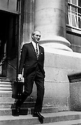 Minister for Finance, George Colley, leaving the department of Finance on his way to Dail Eireann to deliver his Budget speech.<br />