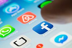 Facebook social media app logo on screen of iPhone 6 Plus smart phone