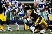 Dallas Cowboys running back DeMarco Murray (29) slips through Pittsburgh Steelers' tackles at Cowboys Stadium in Arlington, Texas, on December 16, 2012.  (Stan Olszewski/The Dallas Morning News)