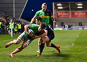 Harlequins flanker Jack Clifford crosses the line for a try despite the efforts of Sale Sharks full back Luke James during a Gallagher Premiership match at the AJ Bell Stadium, Eccles, Greater Manchester, United Kingdom, Friday, April 5, 2019. (Steve Flynn/Image of Sport)