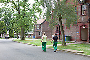 Prisoners walking in the grounds of the prison. HMP Styal, Wilmslow, Cheshire