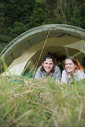 Portrait of young couple relaxing in camp tent, Bavaria, Germany