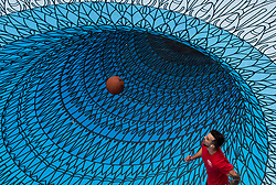 Andrew Clark plays basketball in the atrium of the Woodward's building on a mural placed on the ground to mark World Sight Day, in Vancouver, B.C., on Tuesday October 17, 2017. Photo by Darryl Dyck/The Canadian Press/ABACAPRESS.COM