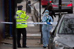 © Licensed to London News Pictures.16/02/2021, London, UK. Forensic and Police gathered evidence the  crime scene after a man was fatally stabbed in North London. Police were called to Highgate Road around 7:40pm on Monday. A man was pronounced dead at the scene. Police arrested two men after arriving at Kentish Town. Photo credit: Marcin Nowak/LNP