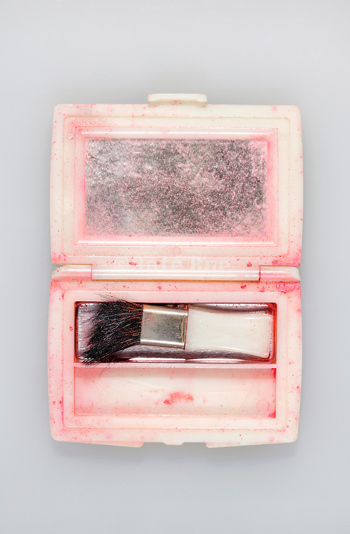 empty make up box with brush and mirror