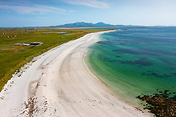 Benbecula, Outer Hebrides, Scotland, UK. 24 July  2021. When beaches in the rest United Kingdom are packed with sun worshippers on another hot sunny weekend day, a solitary woman enjoys the white sands on an empty beautiful beach on the west coast of Benbecula in the Outer Hebrides in Scotland, UK. Iain Masterton/Alamy Live news.