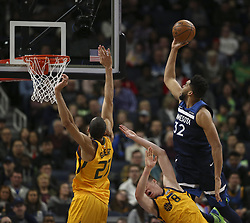 April 1, 2018 - Minneapolis, MN, USA - Minnesota Timberwolves center Karl-Anthony Towns (32) is fouled as he shoots by Utah Jazz forward Jonas Jerebko (8) in the second quarter on Sunday, April 1, 2018 at Target Center in Minneapolis, Minn. (Credit Image: © Jeff Wheeler/TNS via ZUMA Wire)