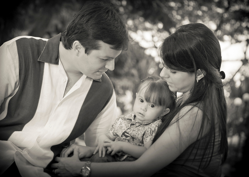 Parents and daughter portrait in black & white