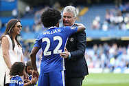 Guus Hiddink, the interim Chelsea manager with Willian of Chelsea during a walk around the pitch after full time. Barclays Premier league match, Chelsea v Leicester city at Stamford Bridge in London on Sunday 15th May 2016.<br /> pic by John Patrick Fletcher, Andrew Orchard sports photography.