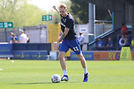 AFC Wimbledon midfielder Mitchell (Mitch) Pinnock (11) warming up during the EFL Sky Bet League 1 match between AFC Wimbledon and Bristol Rovers at the Cherry Red Records Stadium, Kingston, England on 19 April 2019.