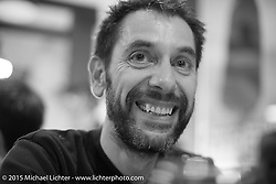 Jean-Louis Theuil, the art director of Freeway France and Moto Heroes Magazines in Francer, at dinner during EICMA, the largest international motorcycle exhibition in the world. Milan, Italy. November 18, 2015.  Photography ©2015 Michael Lichter.
