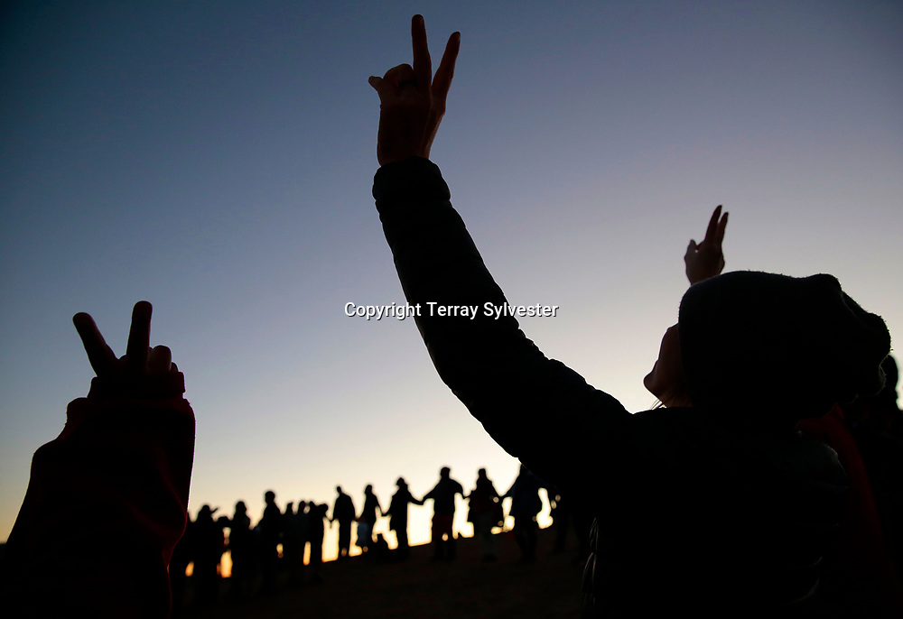 People cheer during a gathering in the opposition camp against the Dakota Access oil pipeline on November 13, 2016. Cannon Ball, North Dakota, United States.
