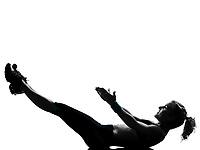 one woman exercising workout fitness aerobic exercise abdominals push ups lying on back posture on studio isolated white background