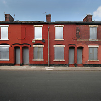 Condemned red brick terraced housing in Salford due for demolition