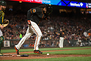 San Francisco Giants starting pitcher Johnny Cueto (47) runs to first base after a bunt against the Oakland Athletics at AT&T Park in San Francisco, California, on March 30, 2017. (Stan Olszewski/Special to S.F. Examiner)