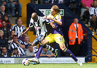 Swansea City's Michu tackles West Bromwich Albion's Youssuf Mulumbu<br />  (Photo by Kieran Galvin/CameraSport) <br /> <br /> Football - Barclays Premiership - West Bromwich Albion v Swansea City - Sunday 1st September 2013 - The Hawthorns - West Midlands<br /> <br /> © CameraSport - 43 Linden Ave. Countesthorpe. Leicester. England. LE8 5PG - Tel: +44 (0) 116 277 4147 - admin@camerasport.com - www.camerasport.com