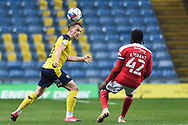 Oxford United defender Sam Long (12) heads the ball during the EFL Sky Bet League 1 match between Oxford United and Swindon Town at the Kassam Stadium, Oxford, England on 28 November 2020.