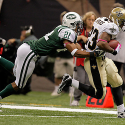 2009 October 04: New Orleans Saints running back Pierre Thomas (23) runs by New York Jets cornerback Dwight Lowery (21) during the first half of a week four regular season game between the New Orleans Saints and the New York Jets at the Louisiana Superdome in New Orleans, Louisiana.