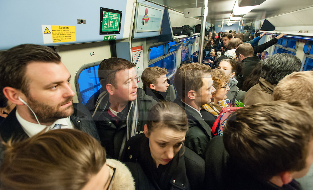 © Licensed to London News Pictures. 30/01/2015. London, UK. Commuters suffer severely overcrowded conditions aboard a Thameslink cross London service during Friday morning rush hour, travelling into Central London.  Thames link are running a reduced carriage service as a result of flooding between Farringdon and St Pancras International due to a burst water main.. Photo credit : Richard Isaac/LNP
