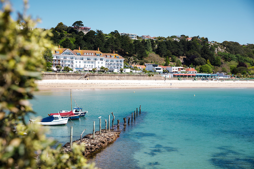 White sand and turquoise calm water at St Brelade's Bay, a popular tourist destination in Jersey, Channel Islands