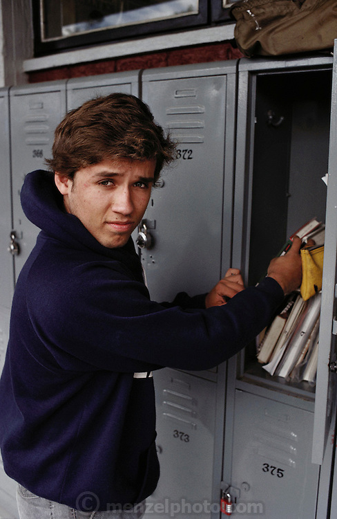 Teenage boy getting books out of his locker at a private high school Guadalajara, Mexico.