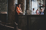 A boy watches the swirl of tourists inside the Ayasofya, or Hagia Sophia, in Istanbul, Turkey. A church built in the 6th century during the Byzantine era, it was converted into a mosque in the wake of the Ottoman takeover in 1453. In 1935 it was turned into a musuem.  (July 25, 2010)