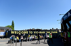 A general view of fans outside the grounds before the Premier League match at Vicarage Road, Watford.